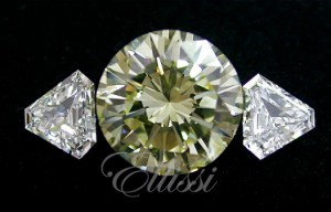 Light fancy yellow diamond at 3 ct with white shield diamonds