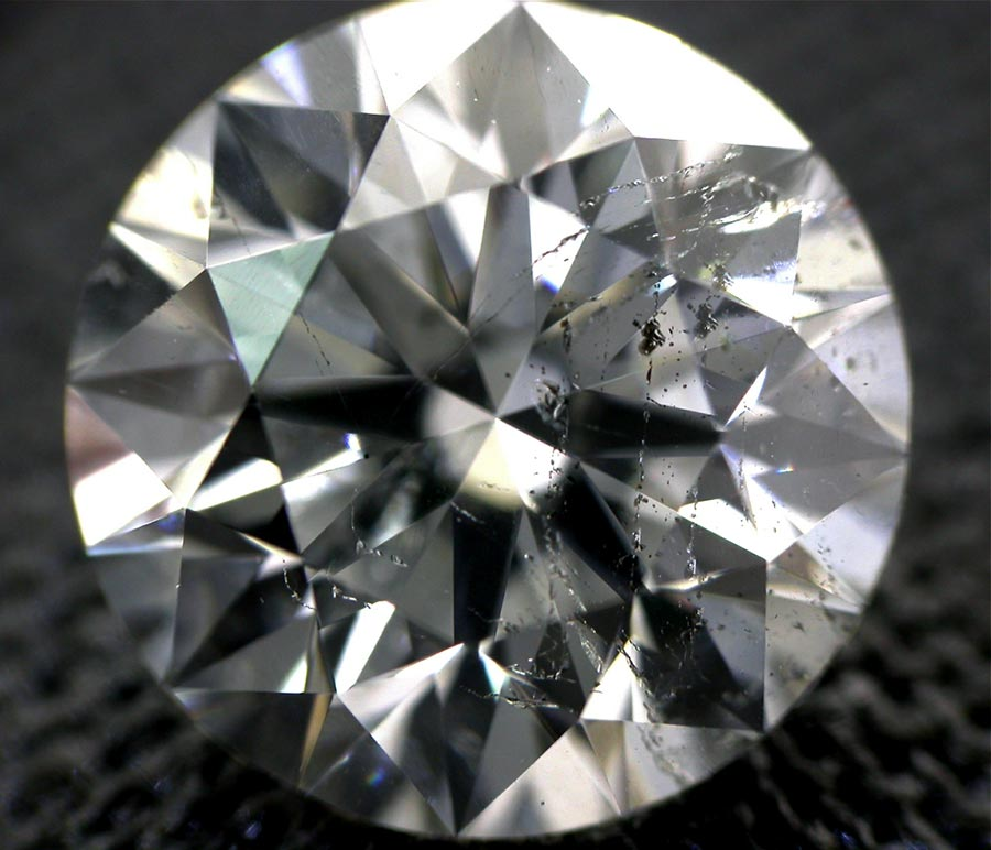 Dodgy diamonds to be avoided. This diamond shows just how bad the inclusions can look and the detrimental affect this will have on the sparkle of the diamond.