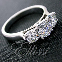 """Faustina"" Three stone round brilliant cut diamond ring."