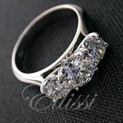 """Gusta"" Three stone claw set diamond ring."
