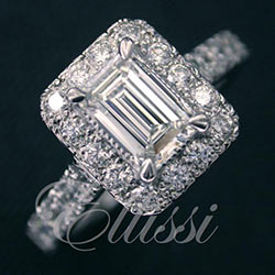 """Clio"" Emerald cut diamond in a halo design."