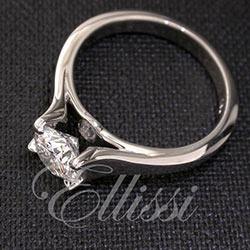 """""""Alisier"""" Round brilliant cut solitaire with a twist."""