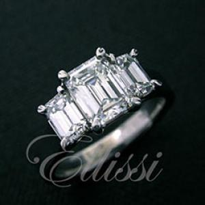 Three-stone Emerald cut diamond trilogy ring.