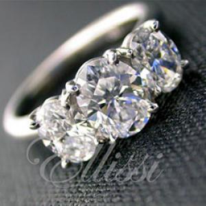 """Sylvia"" Three-stone oval cut diamond ring."