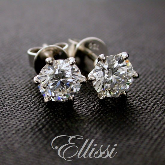 Diamond stud earrings, just under half a carat of diamond each