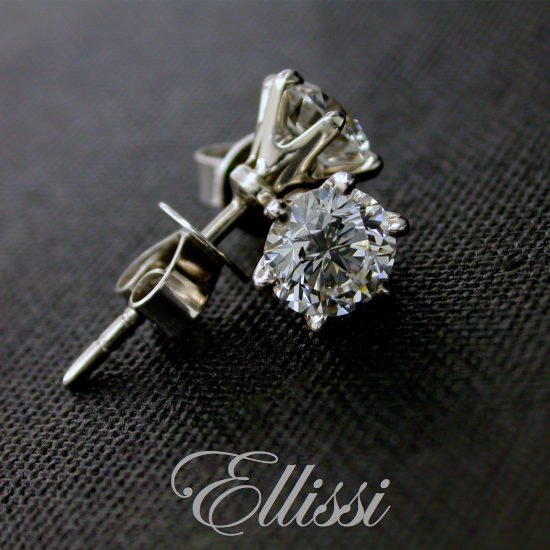 Six claw diamond stud earrings